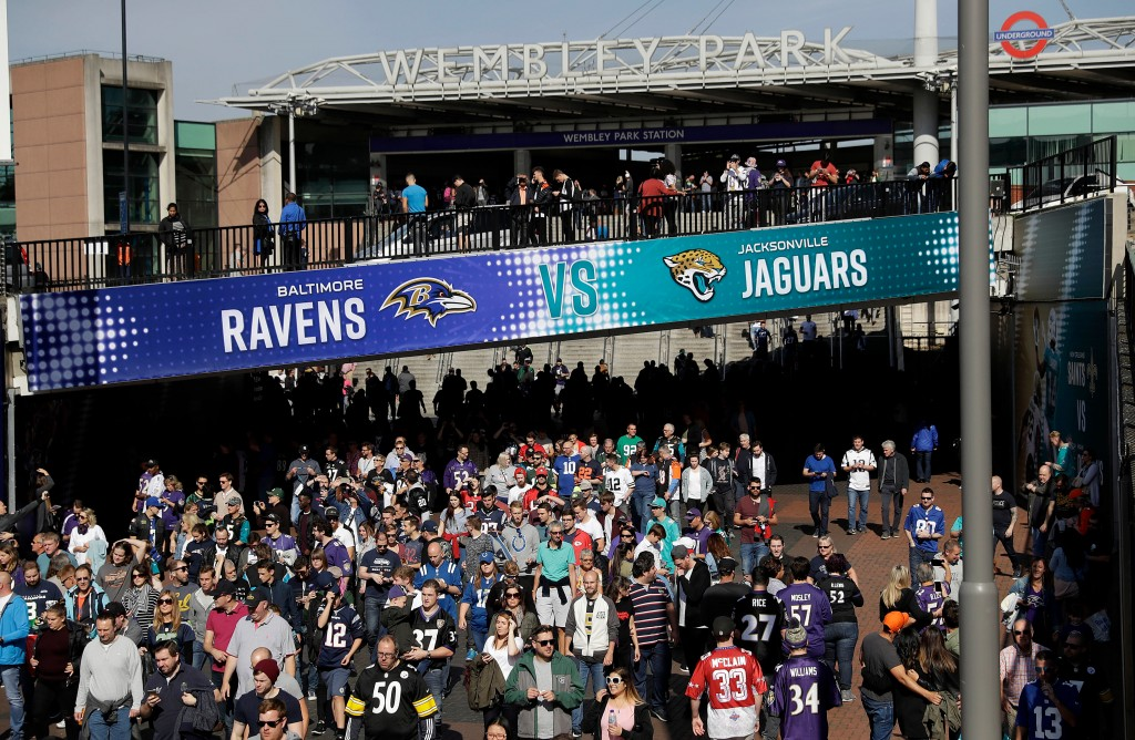 FILE - In this Sept. 24, 2017, file photo, fans walk up Wembley Way as they arrive for an NFL football game between the Jacksonville Jaguars and the B...