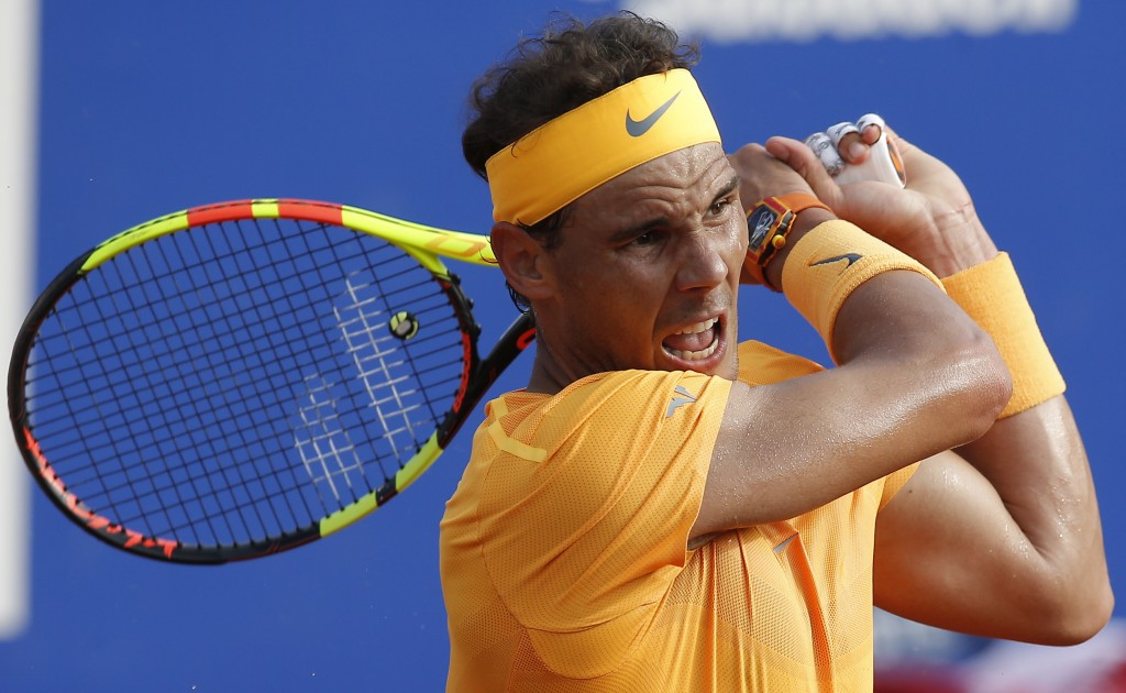 Rafael Nadal of Spain returns the ball to Martin Klizan of Slovakia during the Barcelona Open Tennis Tournament in Barcelona, Spain, Friday, April 27,...