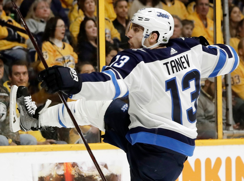Winnipeg Jets left wing Brandon Tanev celebrates after scoring a goal against the Nashville Predators during the first period in Game 1 of an NHL hock...