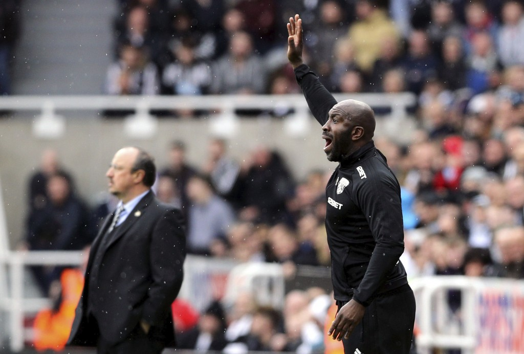 West Bromwich Albion caretaker manager Darren Moore gestures with Newcastle United manager Rafael Benitez in the background on the touchline, during t...