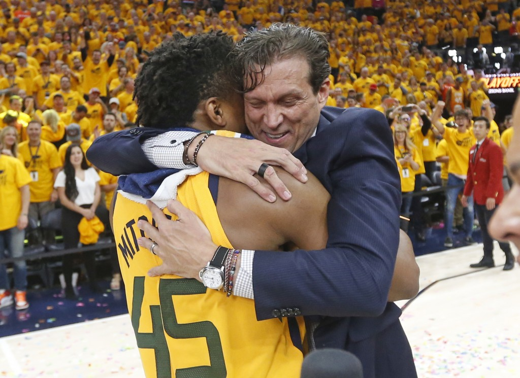 Utah Jazz coach Quin Snyder hugs guard Donovan Mitchell (45) after the team's 96-91 victory over the Oklahoma City Thunder during Game 6 of an NBA bas...