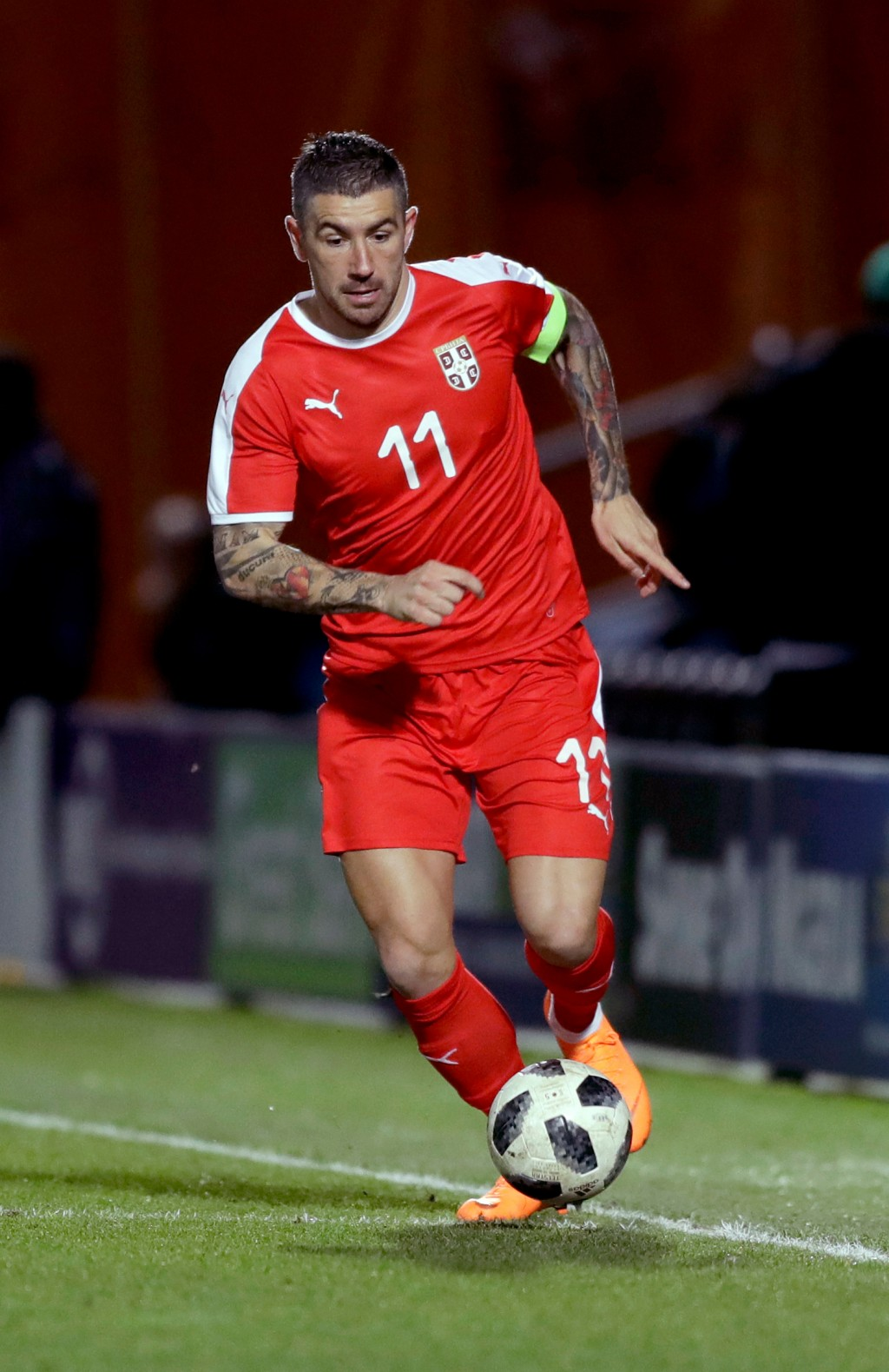 In this photo taken on Tuesday, March 27, 2018, Serbia's Aleksandar Kolarov runs with the ball during the international friendly soccer match between ...