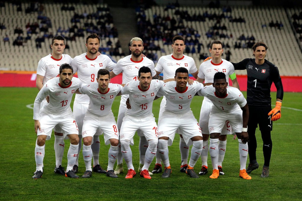 In this photo taken on Friday, March 23, 2018, Switzerland team poses for the photographers before an international friendly soccer match against Gree...