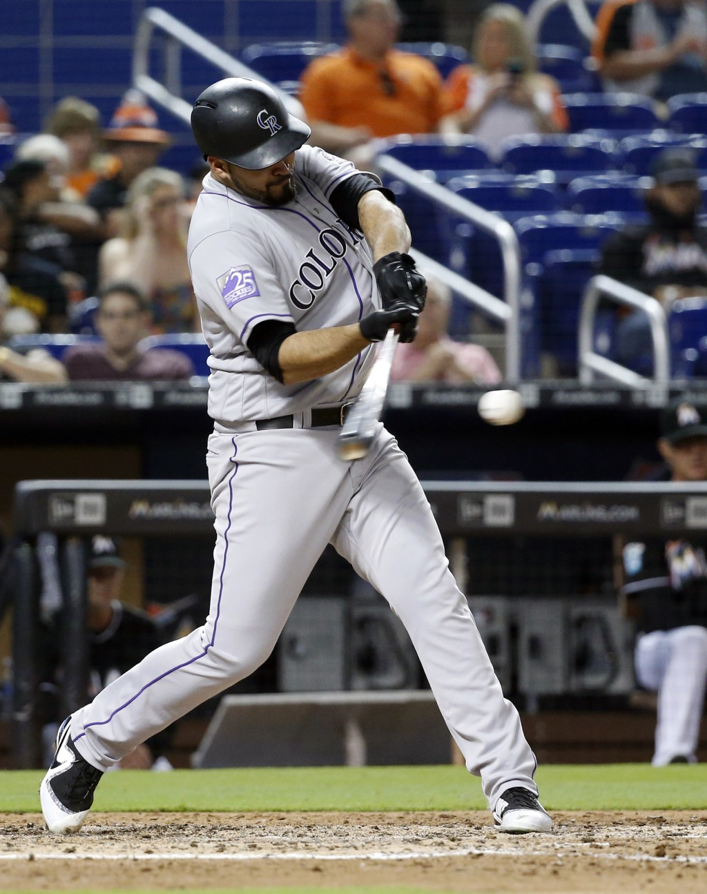 Colorado Rockies' Antonio Senzatela hits a double scoring Gerardo Parra during the fifth inning of a baseball game against the Miami Marlins, Friday, ...