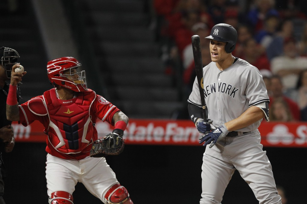 New York Yankees' Aaron Judge, right, reacts after striking out as Los Angeles Angels catcher Martin Maldonado throws the ball during the fourth innin...