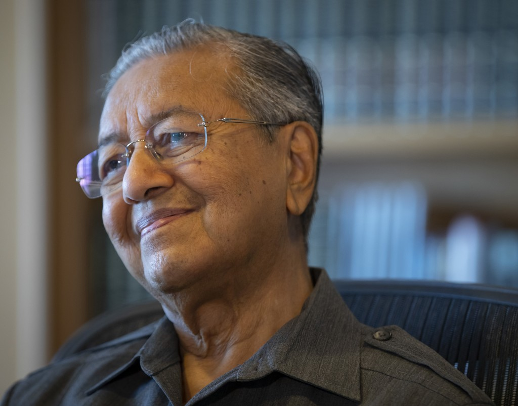 FILE - In this April 18, 2018, file photo, former Malaysian strongman Mahathir Mohamad smiles during an interview at his office in Putrajaya, Malaysia...