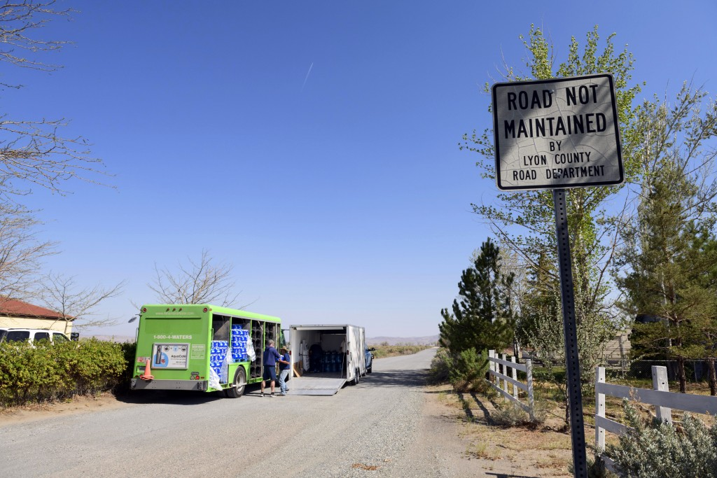 A water truck brings nearly twenty tons of water to the border of the Yerington Paiute reservation, where it is then transferred to other vehicles and...