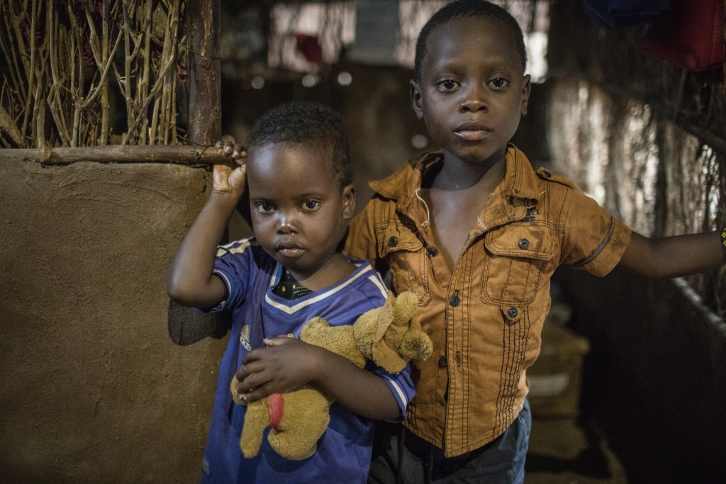 In this April 16, 2018 photo, three-year-old Shukri Muhamed, left, and her brother Ibrahim, 6, stand in their home at the Kakuma Refugee Camp in Kakum...