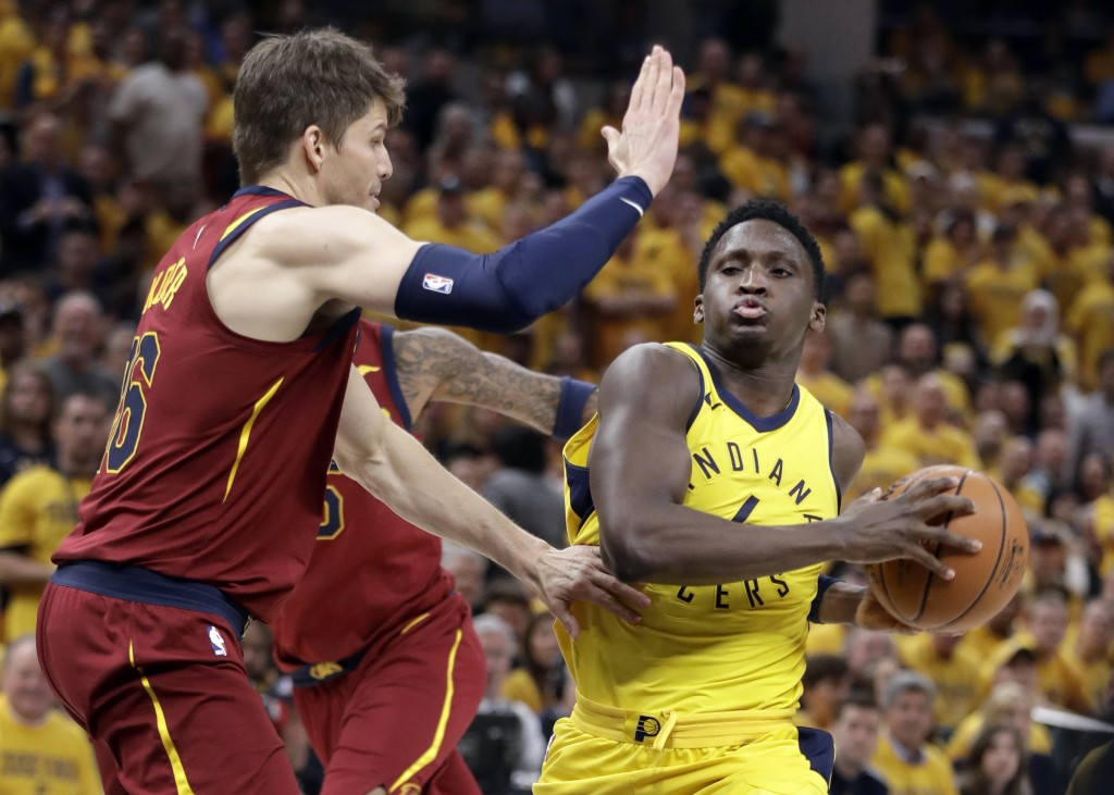 Indiana Pacers' Victor Oladipo, right, heads to the basket as Cleveland Cavaliers' Kyle Korver defends during the second half of Game 6 of a first-rou...