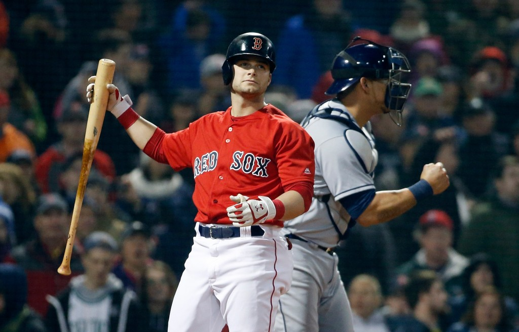 Boston Red Sox's Andrew Benintendi, left, reacts beside Tampa Bay Rays' Wilson Ramos after striking out to end the baseball game during the ninth inni...