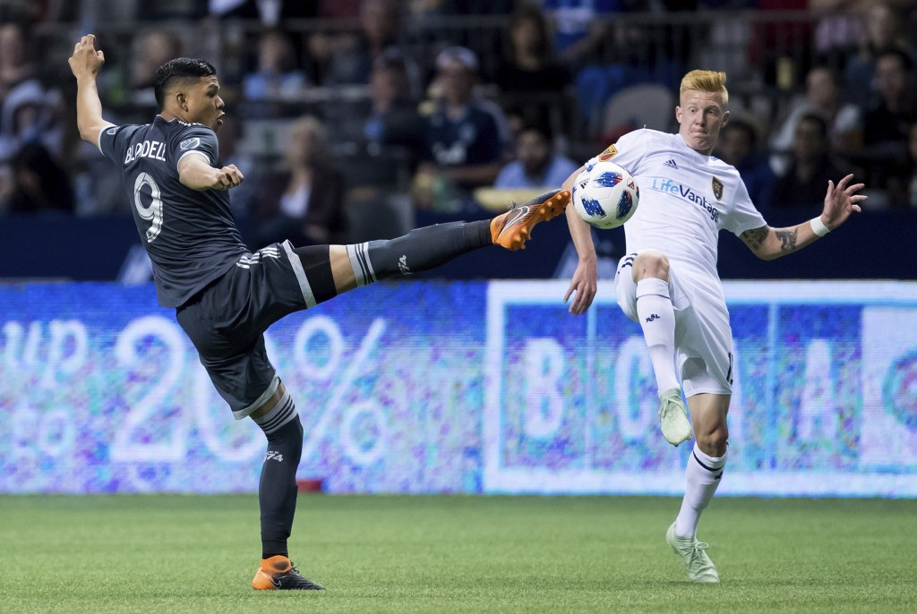 Vancouver Whitecaps' Anthony Blondell, left, and Real Salt Lake's Justen Glad vie for the ball during the second half of an MLS soccer match Friday, A...
