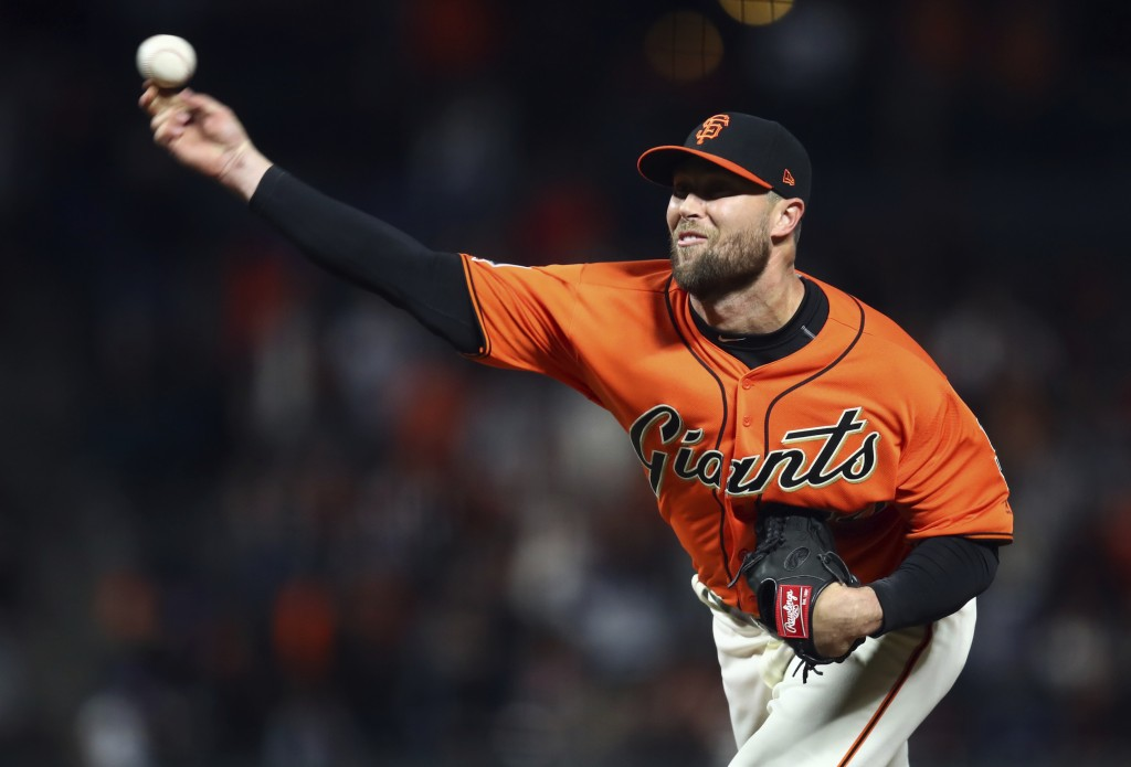 San Francisco Giants pitcher Hunter Strickland works against the Los Angeles Dodgers in the ninth inning of a baseball game, Friday, April 27, 2018, i...