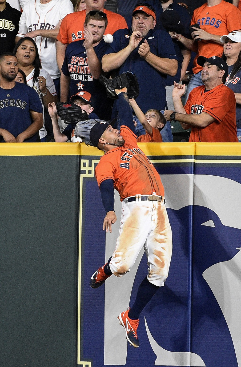 Houston Astros right fielder George Springer attempts to catch a two-run home by Oakland Athletics' Mark Canha during the seventh inning of a baseball...
