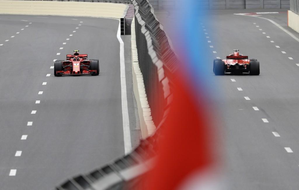 Ferrari driver Kimi Raikkonen of Finland, left, and Ferrari driver Sebastian Vettel of Germany steer their cars during the third free practice session...