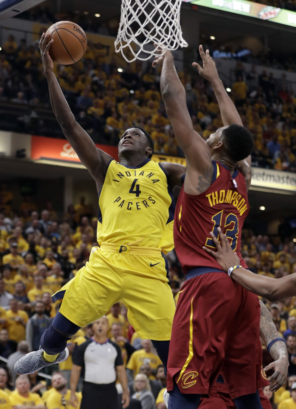 Indiana Pacers' Victor Oladipo (4) shoots over Cleveland Cavaliers' Tristan Thompson during the second half of Game 6 of a first-round NBA basketball ...
