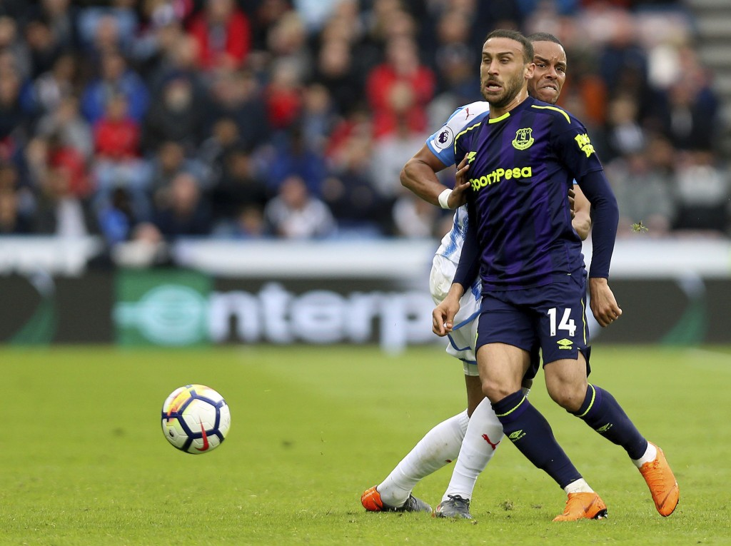 Everton's Cenk Tosun, front, and Huddersfield Town's Mathias Jorgensen, during their English Premier League soccer match at the John Smith's Stadium i...