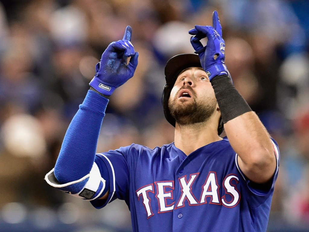 Texas Rangers third baseman Joey Gallo celebrates after hitting a two-run home run against the Toronto Blue Jays during the first inning of a baseball...