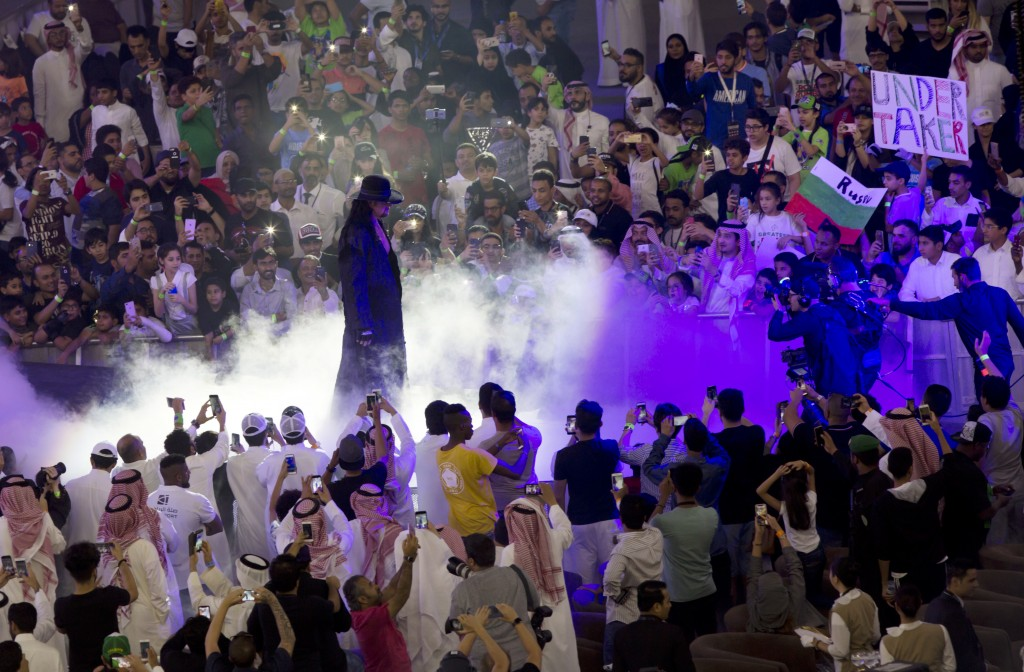 "World Wrestling Entertainment star The Undertaker is greeted by fans during a match of the ""Greatest Royal Rumble"" event in Jiddah, Saudi Arabia, Frid..."
