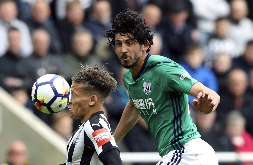West Bromwich Albion's Ahmed Hegazi, right, and Newcastle United's Dwight Gayle battle for the ball, during the English Premier League soccer match be...