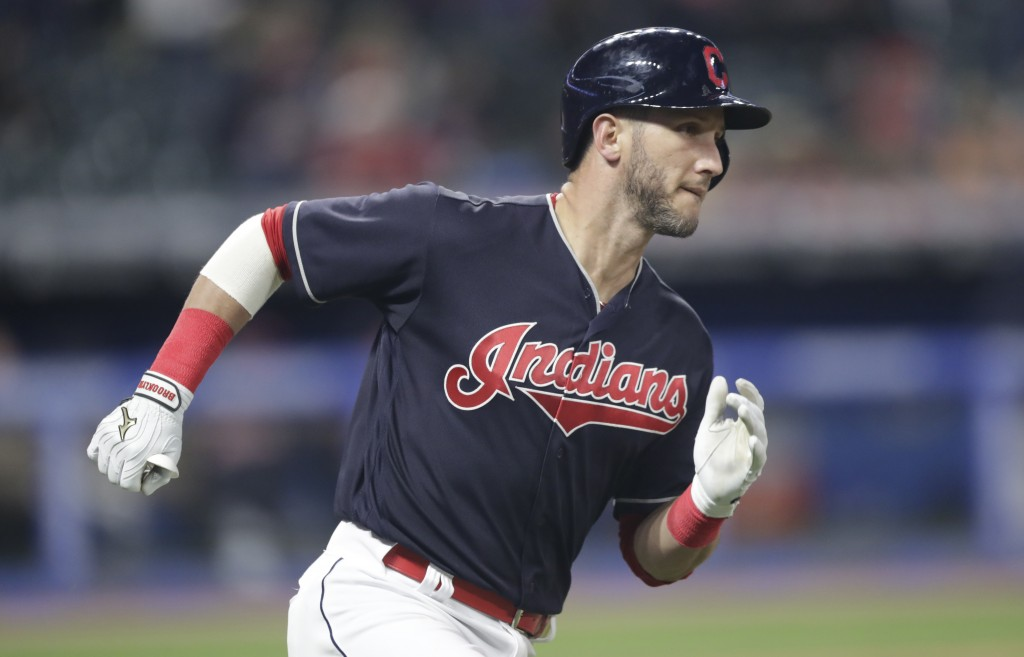 Cleveland Indians' Yan Gomes runs the bases after hitting a solo home run off Seattle Mariners starting pitcher Erasmo Ramirez during the sixth inning...