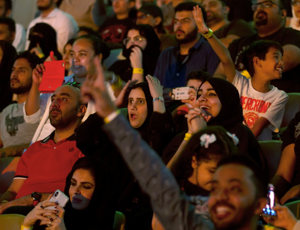 """Fans react as they watch the World Wrestling Entertainment Inc.'s """"Greatest Royal Rumble"""" event in Jiddah, Saudi Arabia, Friday, April 27, 2018. A pre..."""