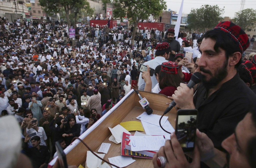 In this Sunday, April 22, 2018 photo, Manzoor Pashteen, a leader of Pashtun Protection Movement addresses his supporters during a rally in Lahore, Pak...