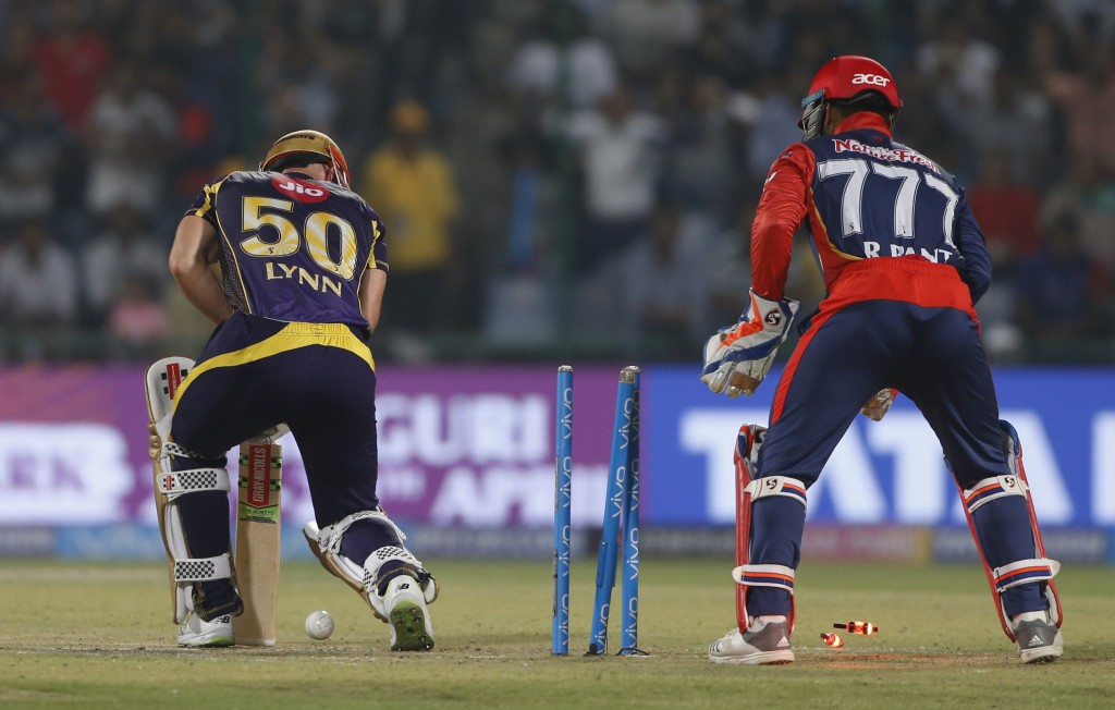 Kolkata Night Riders' Chris Lynn is bowled by Delhi Daredevils' Glenn Maxwell during their VIVO IPL cricket T20 match in New Delhi, India, Friday, Apr...