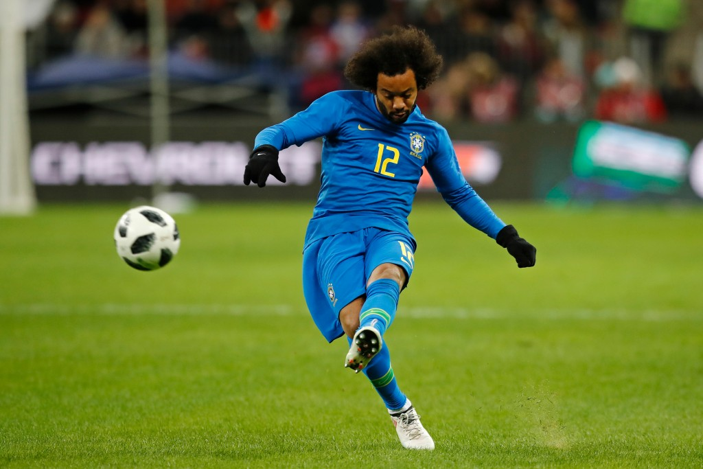In this photo taken on Friday, March 23, 2018, Brazil's Marcelo shoots during an international friendly soccer match between Russia and Brazil at the ...