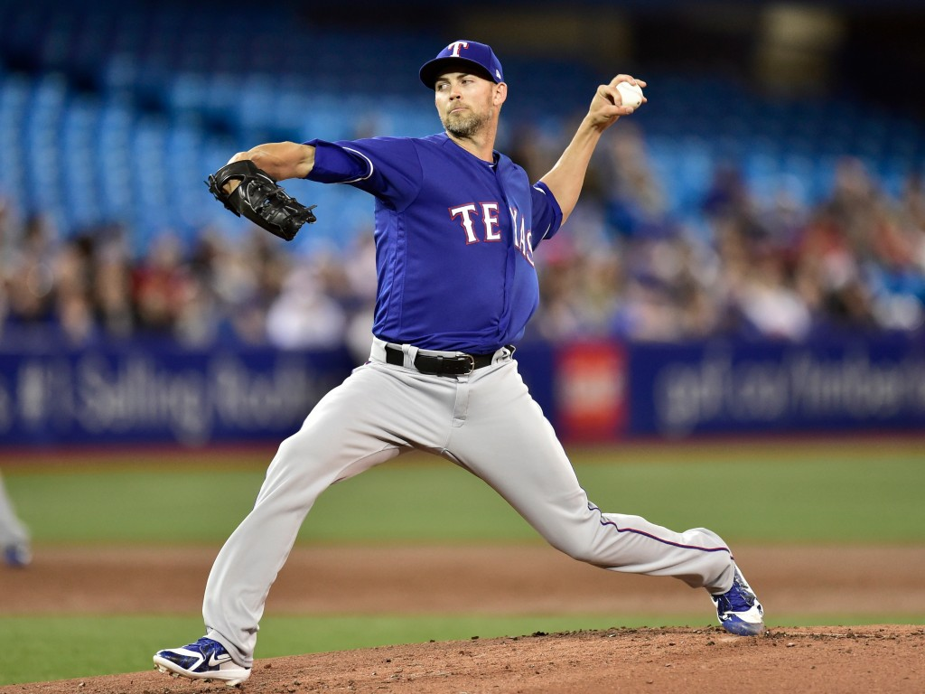 Texas Rangers starting pitcher Mike Minor throws to a Toronto Blue Jays batter during the first inning of a baseball game Friday, April 27, 2018, in T...