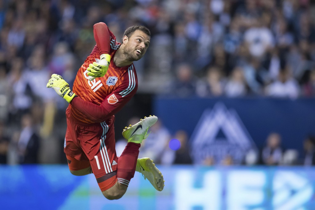 Vancouver Whitecaps goalkeeper Stefan Marinovic watches the ball after making a save against Real Salt Lake during the first half of an MLS soccer mat...