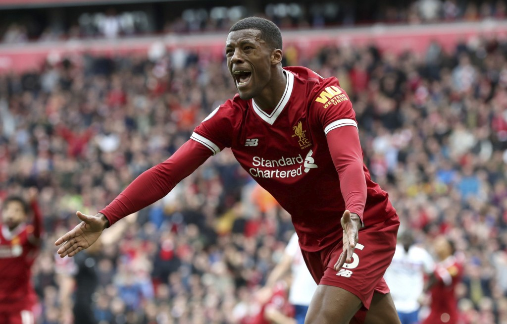 Liverpool's Georginio Wijnaldum reacts during the English Premier League soccer match between Liverpool and Stoke City, at Anfield, in Liverpool, Engl...