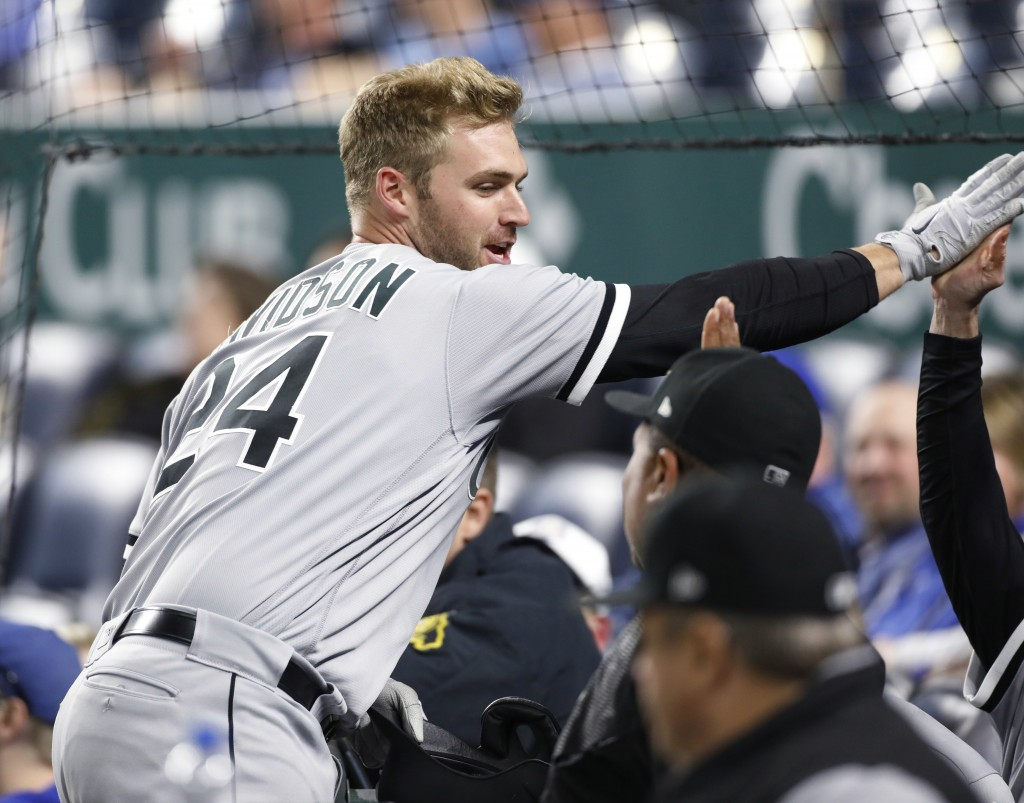 Chicago White Sox designated hitter Matt Davidson (24) celebrates in the dugout after hitting a two-run home run during the 11th inning of a baseball ...