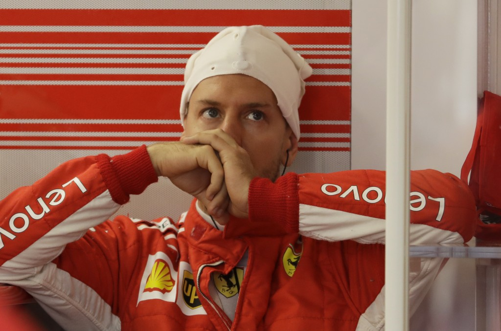 Ferrari driver Sebastian Vettel of Germany sits in the team box during the third free practice session at the Baku Formula One city circuit, in Baku, ...