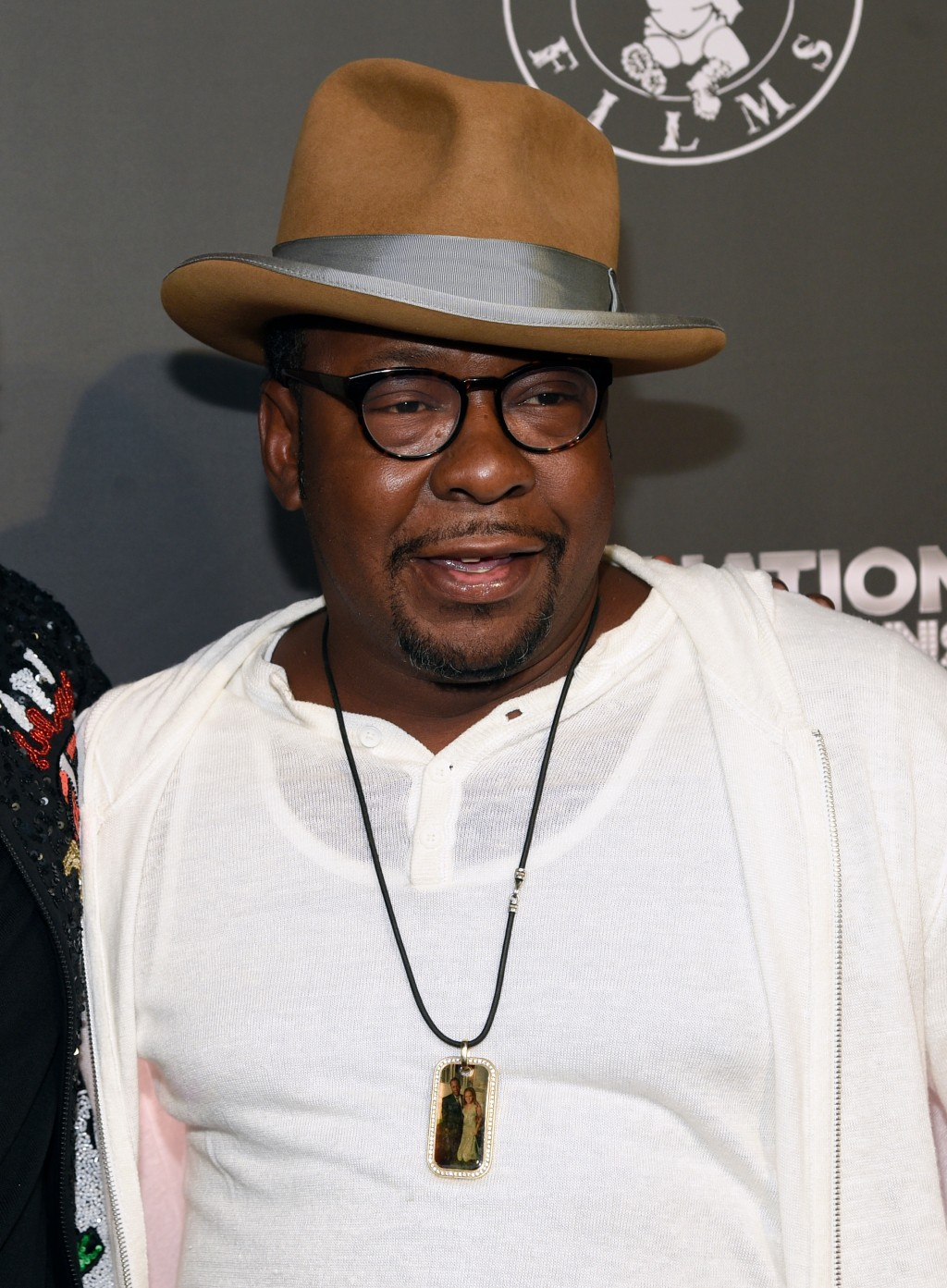 """FILE - In this June 21, 2017 file photo, Bobby Brown wears a photo of his daughter Bobbi Kristina around his neck at the Los Angeles premiere of """"Can'..."""