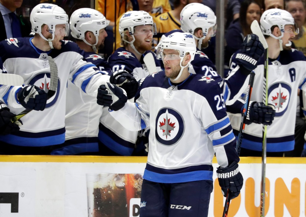 Winnipeg Jets center Paul Stastny (25) is congratulated after scoring a goal against the Winnipeg Jets during the second period in Game 1 of an NHL ho...