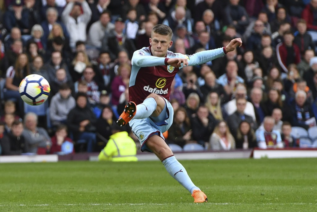 Burnley's Johann Berg Gudmundsson with an unsuccessful shot at goal against Brighton and Hove Albion during their English Premier League soccer match ...