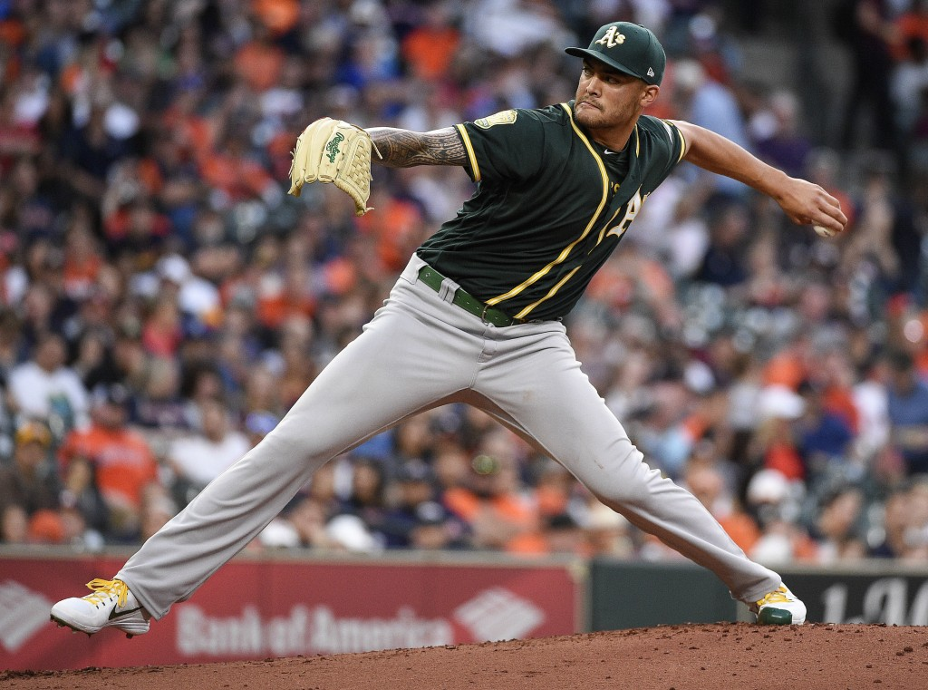 Oakland Athletics starting pitcher Sean Manaea delivers during the second inning of the team's baseball game against the Houston Astros, Friday, April...