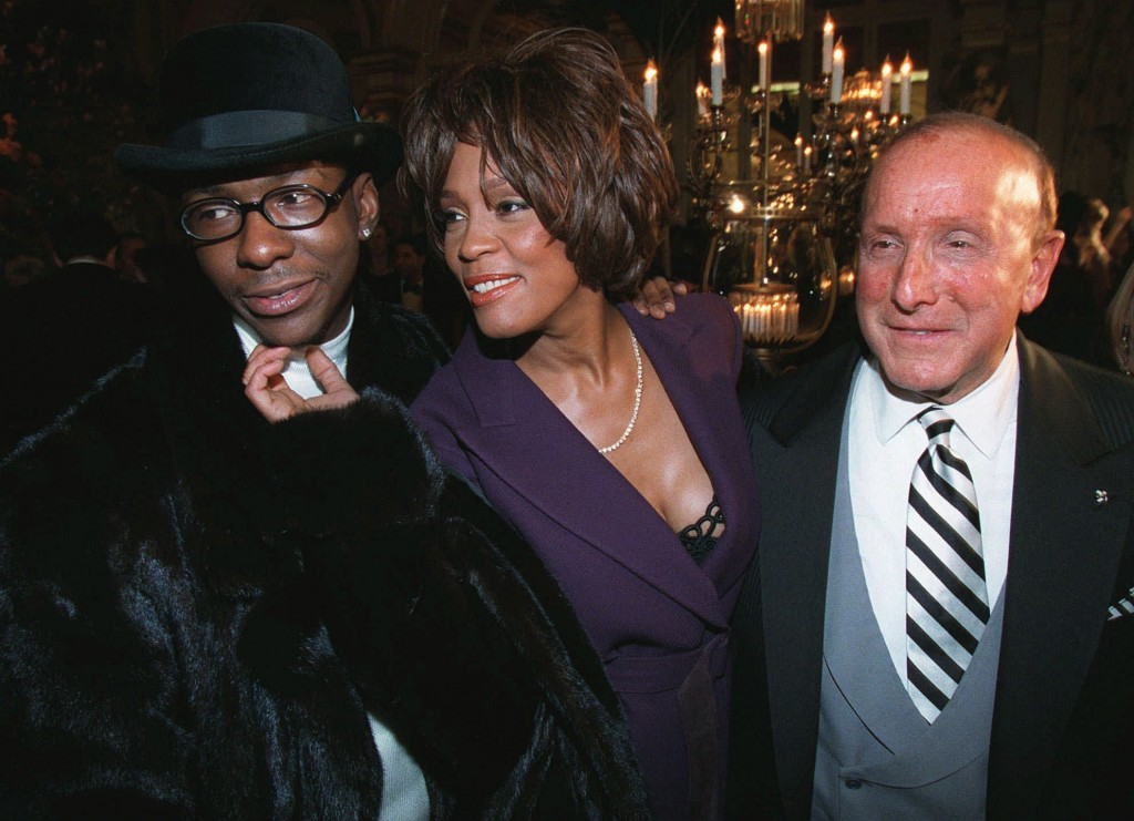 FILE - In this Feb. 24, 1998 file photo, singers Bobby Brown, from left, and Whitney Houston appear with music producer Clive Davis at a pre-Grammy pa...