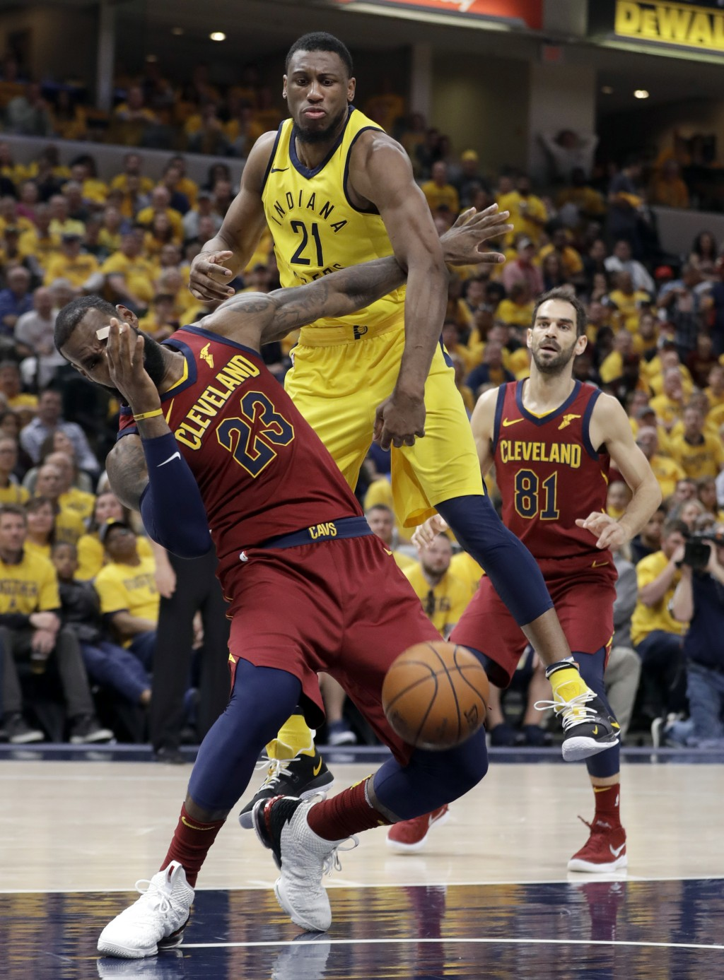 Indiana Pacers' Thaddeus Young (21) and Cleveland Cavaliers' LeBron James (23) collide as Cavaliers' Jose Calderon (81) watches during the second half...