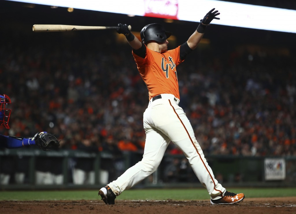 San Francisco Giants' Joe Panik swings for an RBI sacrifice fly against the Los Angeles Dodgers during the seventh inning of a baseball game Friday, A...