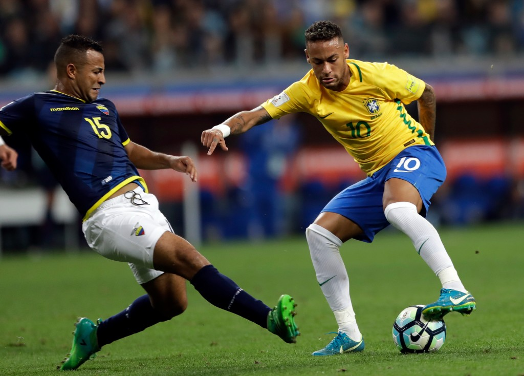 FILE - In this Aug. 31, 2017 file photo, Brazil's Neymar, right, controls the ball against Ecuador's Pedro Quinones, left, during a 2018 World Cup qua...