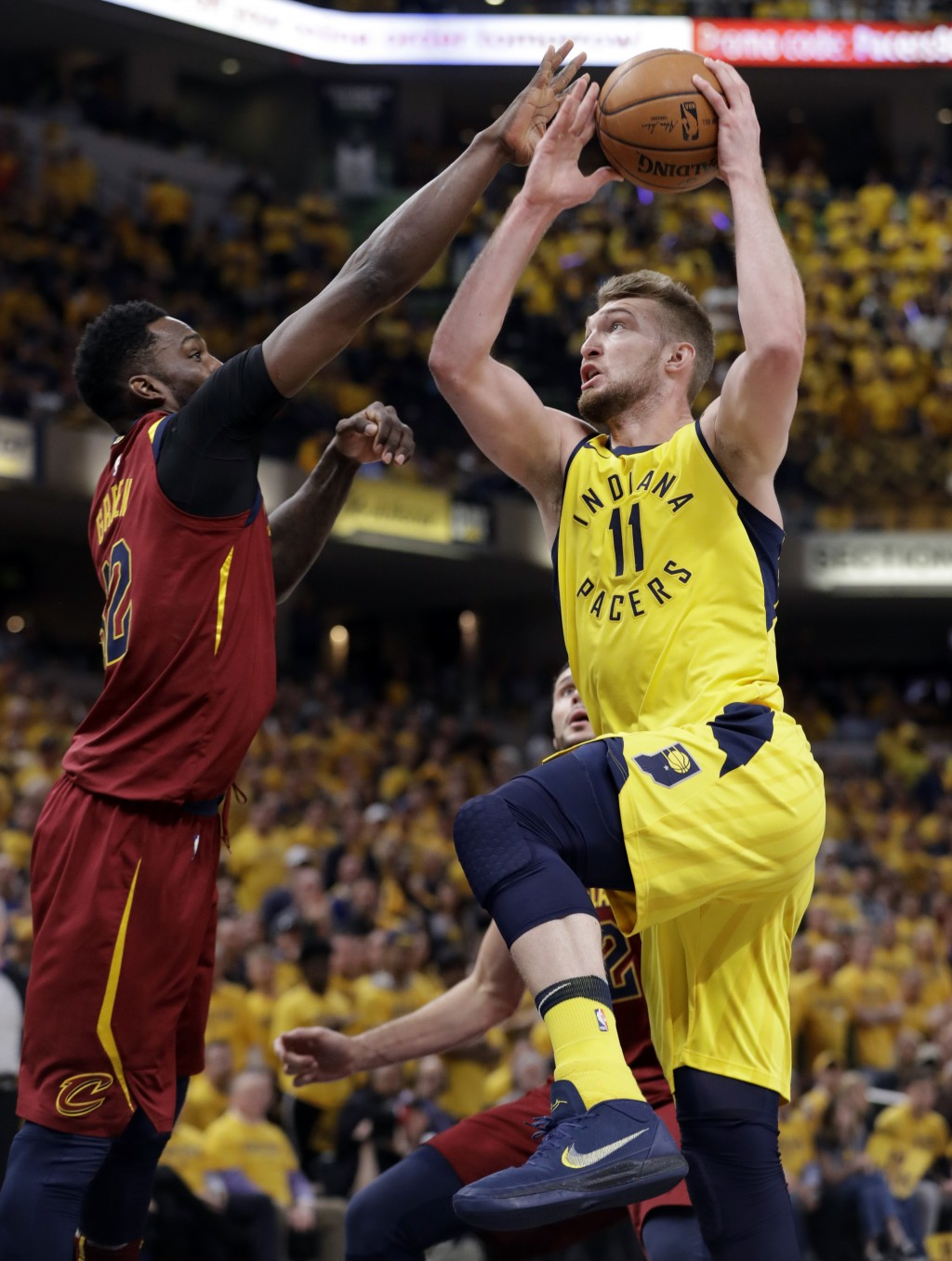 Indiana Pacers' Domantas Sabonis (11) heads to the basket as Cleveland Cavaliers' Jeff Green defends during the second half of Game 6 of a first-round...