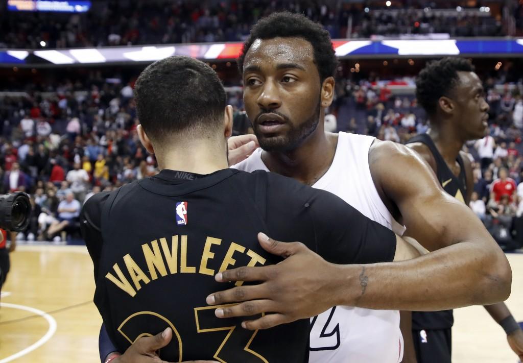 Toronto Raptors guard Fred VanVleet (23) hugs Washington Wizards guard John Wall (2) after Game 6 of an NBA basketball first-round playoff series Frid...