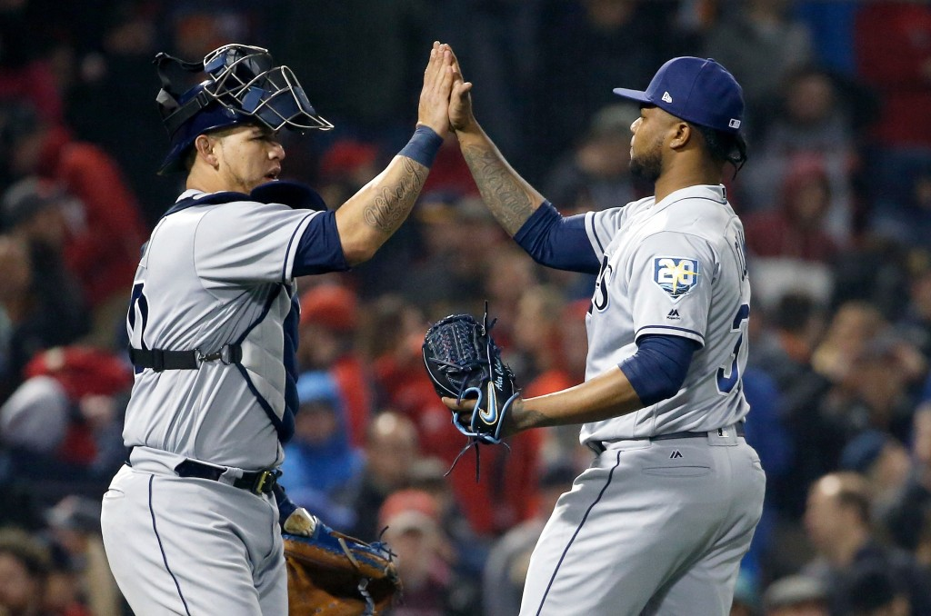 Tampa Bay Rays' Alex Colome, right, and Wilson Ramos celebrate after defeating the Boston Red Sox during a baseball game in Boston, Friday, April 27, ...
