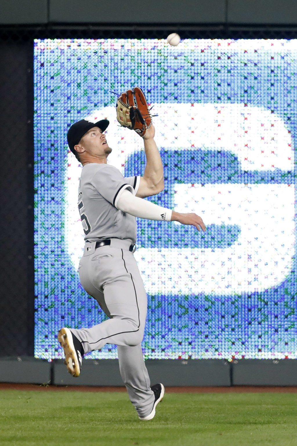 Chicago White Sox center fielder Adam Engel catches a fly ball from Kansas City Royals' Salvador Perez during the seventh inning of a baseball game at...