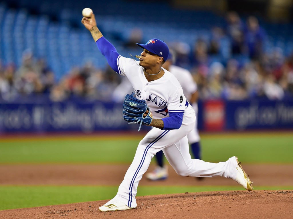 Toronto Blue Jays starting pitcher Marcus Stroman throws to a Texas Rangers batter during the first inning of a baseball game Friday, April 27, 2018, ...