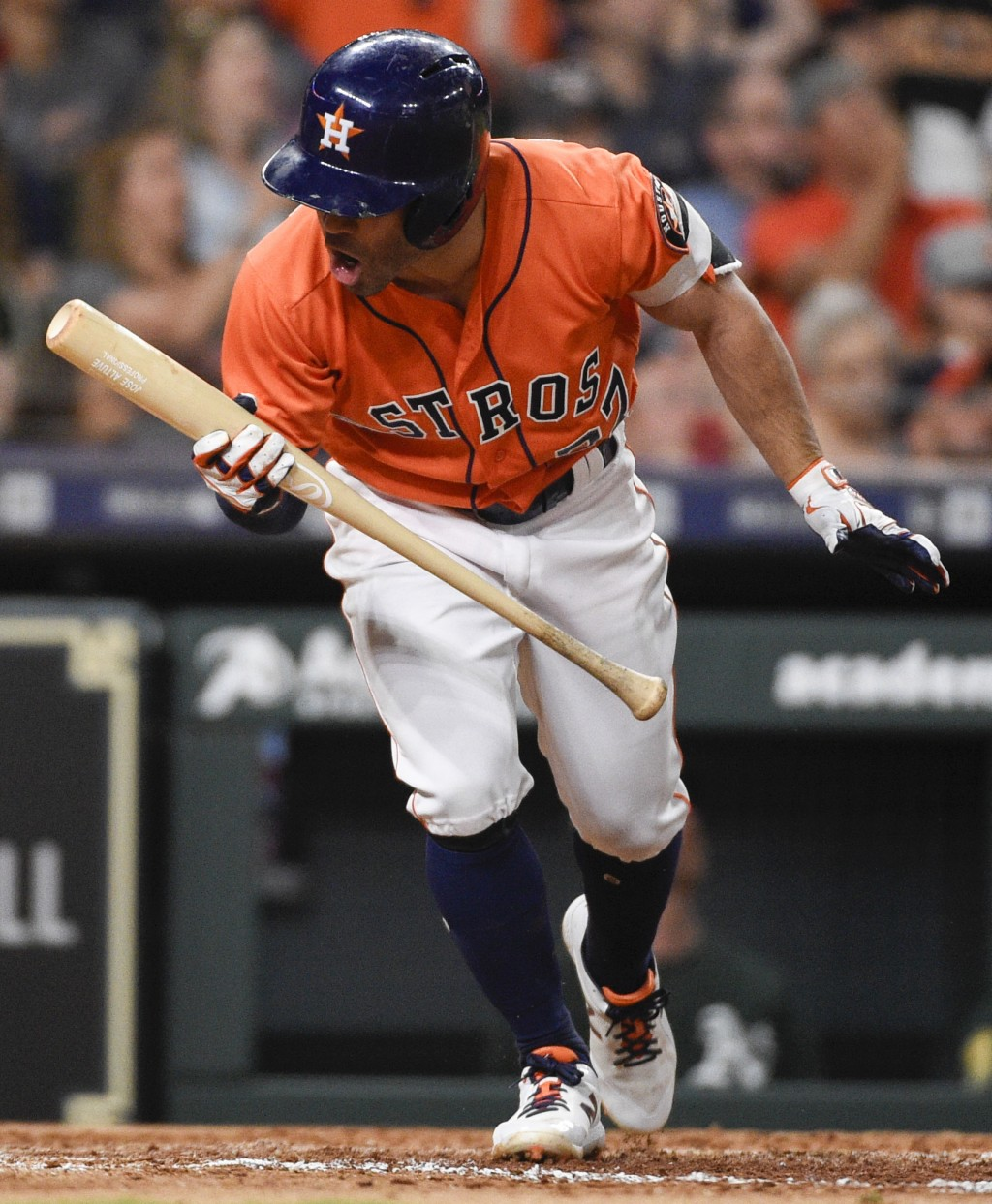 Houston Astros' Jose Altuve reacts after flying out to end the fifth inning of the team's baseball game against the Oakland Athletics, Friday, April 2...