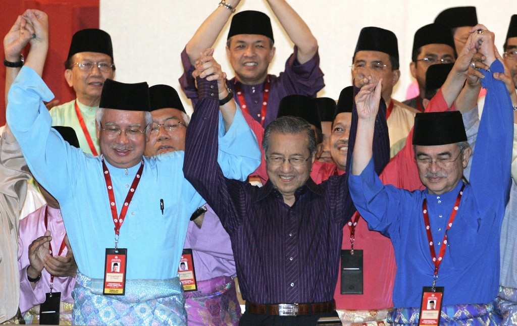 FILE - In this March 28, 2009, file picture, former Malaysian Prime Minister Mahathir Mohamad, center, poses with then Prime Minister Abdullah Ahmad B...