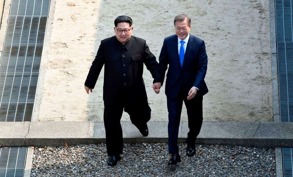 FILE - In this Friday, April 27, 2018, file photo, North Korean leader Kim Jong Un, left, and South Korean President Moon Jae-in cross the military de...