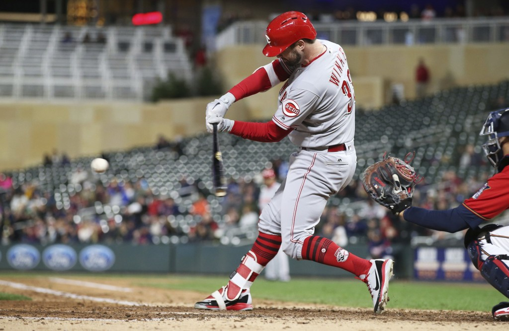 Cincinnati Reds' Jesse Winker hits an RBI-double against the Minnesota Twins in the fourth inning of a baseball game Friday, April 27, 2018, in Minnea...